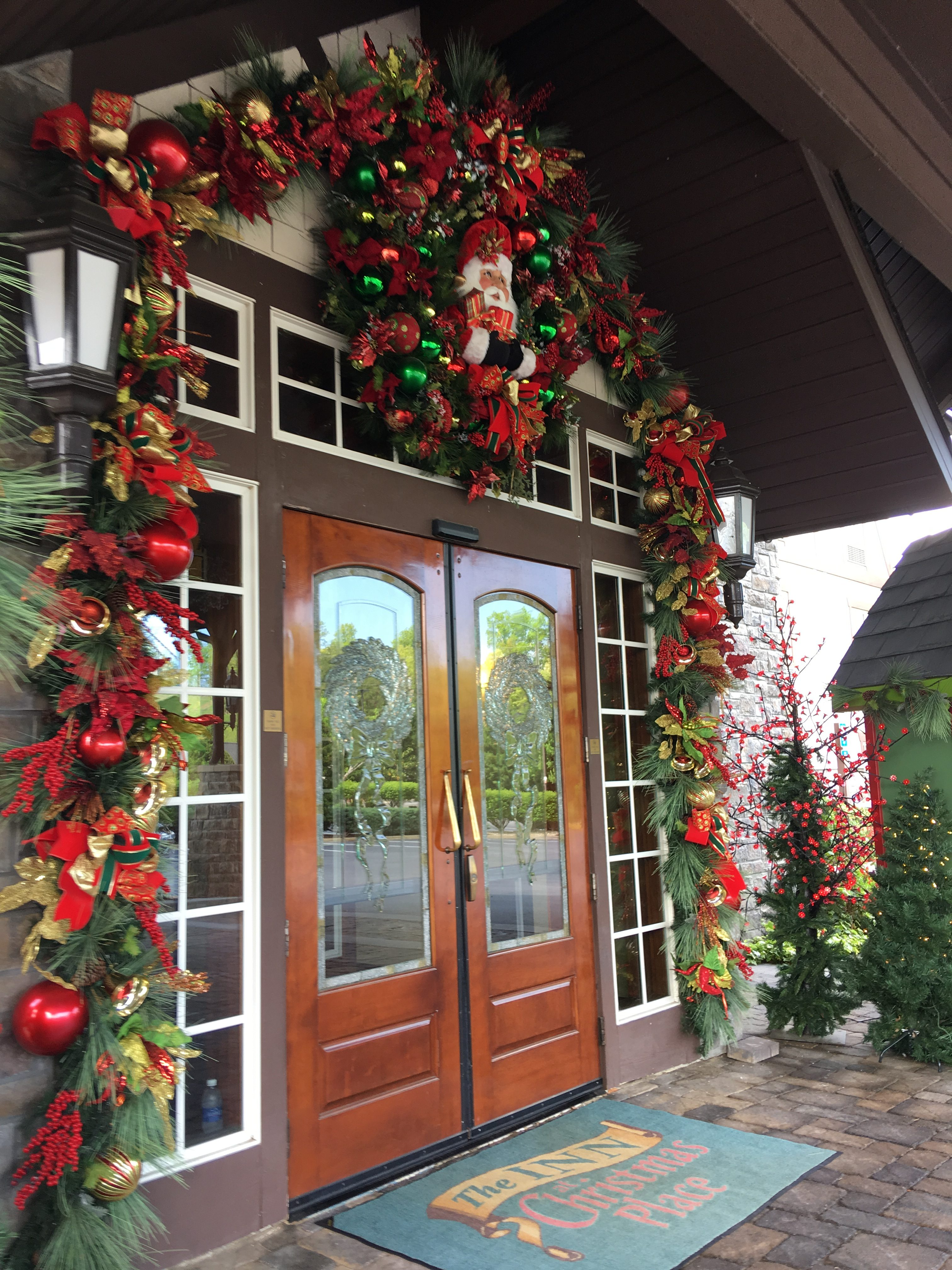we drove up to the inn and was greeted by a suited door man and a bavarian hotel with christmas lights life sized nutcrackers and christmas music it was